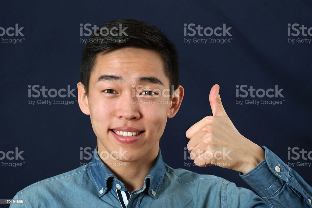 man thumbs Chinese up with